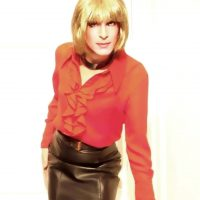 Red blouse and leather mini